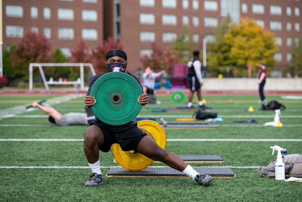 Student Athlete works out in Ron Joyce Stadium. Lifting weights. Student in photo is Ricardo Chisholm
