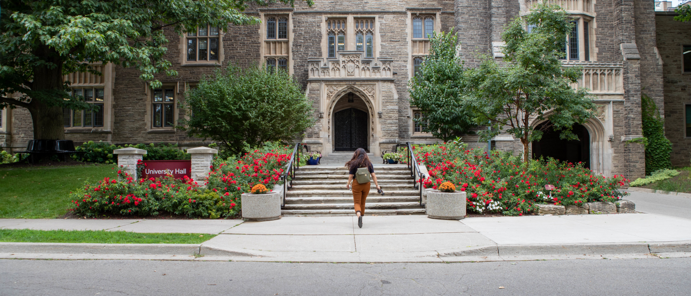 Student in front of University Hall